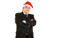 Pleased young businessman in hat of Santa Claus Stock Images