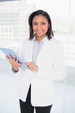 Pleased young dark haired businesswoman using a tablet pc Royalty Free Stock Images