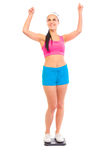 Pleased young fit girl standing on weight scale Stock Photography