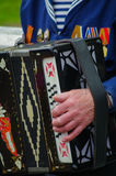 Pleasent veteran plays accordion on the 69-th anniversary of the Stock Image