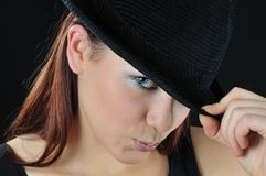 Pleasing girl hold on the hat. One's hand royalty free stock photos
