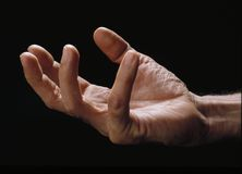 Pleasing hand. Over black background Royalty Free Stock Images