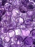 Pleasing purple. Relaxing image of small translucent purple gel beads royalty free stock photography