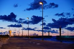 Pleasing view of clouds and sky on the coast of seaside. On a warm summer night stock photography