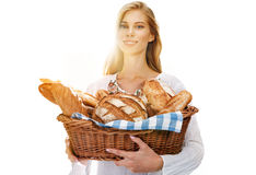 Pleasing woman with bread and rolls Stock Image