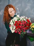 Pleasing young assistant creating a happy mood. For people . sweetsmelling flowers Royalty Free Stock Photos
