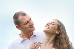 Pleasure. Happy men looking at content female outdoors Royalty Free Stock Image