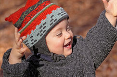 Pleasure. Baby having fun in nature during fall Royalty Free Stock Photo