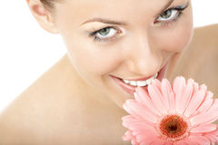 Pleasure from aroma. The woman inhales aroma of a flower and smiles, isolated royalty free stock image