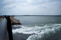 Pleasure Bay Flow. Water from Dorchester Bay gushing into Pleasure Bay, South Boston Stock Photo
