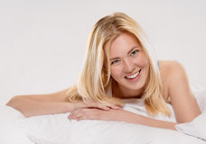 Pleasure in the bed Royalty Free Stock Photography
