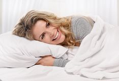 Pleasure in the bed Royalty Free Stock Image