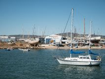 Pleasure boat anchored by beach in Olhao, Algarve, Portugal in summer royalty free stock image