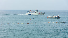Pleasure boat in the bay of Petrovac in Montenegro royalty free stock photo