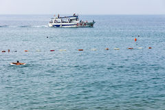 Pleasure boat in the bay of Petrovac, Montenegro Royalty Free Stock Images