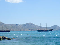 Pleasure boat in Black sea in Koktebel Royalty Free Stock Image