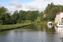 Pleasure boat on the Canal des Voges in France. A pleasure boat on the Canal des Voges in Northern France Stock Photo