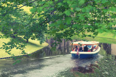 Pleasure boat on the canal in Riga Park Stock Photos