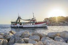 Pleasure boat with cheerful tourists enters the port of Makarska, Croatia. Stock Image