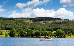 Pleasure boat Coniston town Lake District England uk blue sky summer day Stock Photo