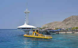 Pleasure boat at the coral reef near underwater observatory Royalty Free Stock Image