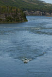 Pleasure boat cruises up the mighty Peace River, northeastern BC Royalty Free Stock Photography