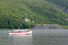 Pleasure boat cruising on a lake in Wales. Royalty Free Stock Photos