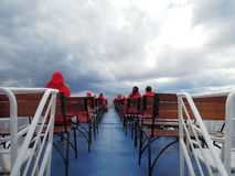 Pleasure boat, deck. The view from the deck of a pleasure craft, the sky clouds Royalty Free Stock Images