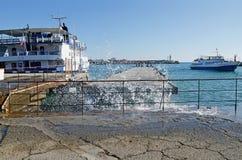 Pleasure boat entering the port of Yalta Stock Photography