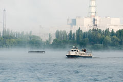 Pleasure boat floating in the reservoir power plant. Stock Image