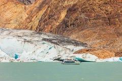 Pleasure boat floats to the glacier Royalty Free Stock Photos