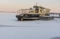 Pleasure boat frozen in on a Dnepr river Stock Photos
