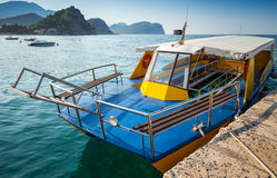 Pleasure boat with glass bottom. Floats moored in Adriatic sea water, Petrovac, Montenegro Stock Images