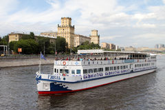Pleasure boat Gzhel sails along the Moscow River. Stock Photos