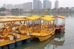 Pleasure boat in the haicang lake. Yellow pleasure boat in the haicang lake, amoy city, china Royalty Free Stock Photo