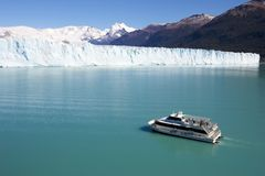 Pleasure boat on lake Argentina. Pleasure boat on cristaline lake Argentina, next to the Perito Moreno glacier in Argentinian Patagonia with a backdrop of the royalty free stock photography