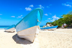 Pleasure boat lays on white sand. Of Macao Beach, coastal landscape. Dominican Republic, Hispaniola Island Stock Image