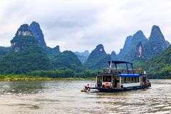 Karst peaks in Xingping Town and pleasure boat on the Li River royalty free stock photography
