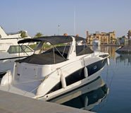 Pleasure boat in a marina. Private motor yacht moored in a marina Stock Images