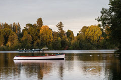 Pleasure boat on mere at Ellesmere Shropshire. Old wooden pleasure boat moored on the mere at Ellesmere Shropshire in England at sunset Royalty Free Stock Photo