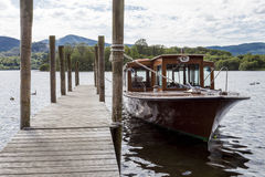 Pleasure Boat moored to jetty on Derwent Water, Keswick. Royalty Free Stock Photo