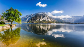 Pleasure boat on a mountain lake in Hallstatt Royalty Free Stock Photos