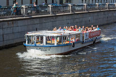 Pleasure boat moves on the river in St. Petersburg, Russia Stock Photo