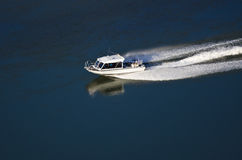 Pleasure Boat Moving Down River Stock Images