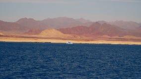 Pleasure boat near a deserted shore stock footage