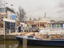 Pleasure boat near the pier in  Amsterdam . Netherlands Stock Photo