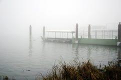 Pleasure boat on the pier, autumn morning. Pleasure boat on the pier, foggy autumn morning royalty free stock photo