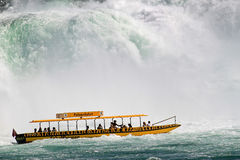 Pleasure boat at the Rhine Falls, Switzerland. Royalty Free Stock Photography