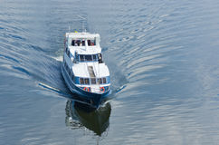 Pleasure boat on a river Stock Images