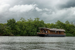 Pleasure boat on the river Bentota. Royalty Free Stock Photography